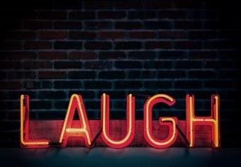 Neon laugh sign