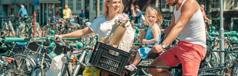 Family Cycling In Amsterdam