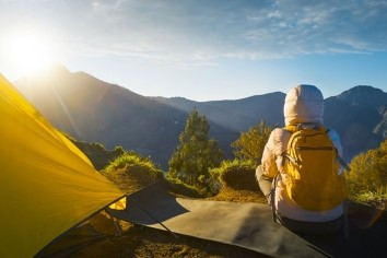 backpacker and tent